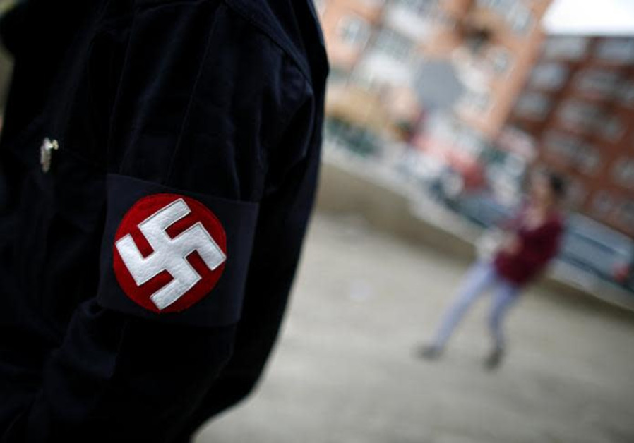 A man wearing a Swastika [Illustrative]
