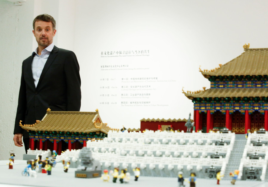Danish Crown Prince Frederik looks at a model of the Forbidden City made of Lego bricks