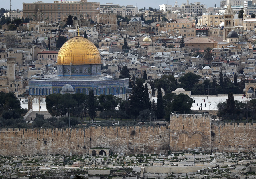 The Golden Gate also known as the Mercy Gate (R) and the Dome of the Rock at the Al-Aqsa mosques