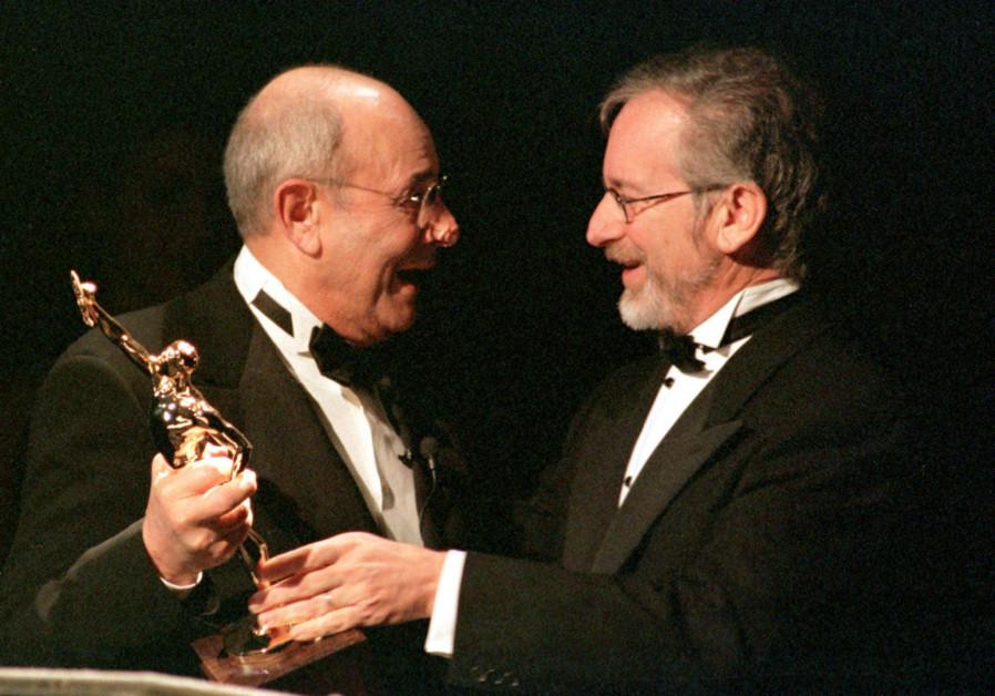 SPIELBERG PRESENTS DONEN WITH ACE GOLDEN EDDIE AWARD FOR BEST FILM MAKER.