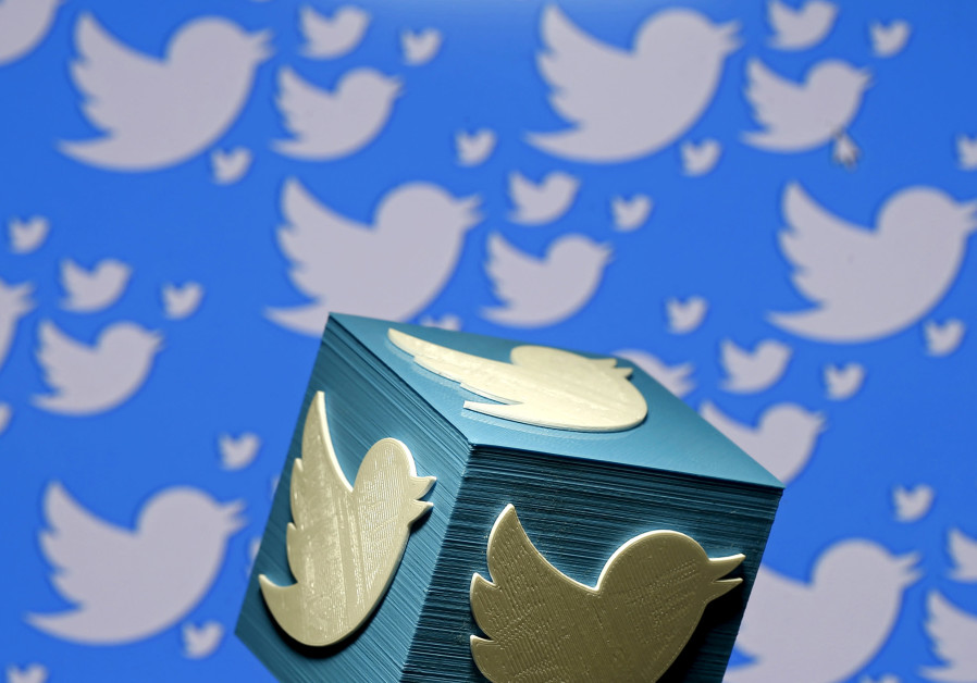 A 3D-printed logo for Twitter is seen in this illustrative picture