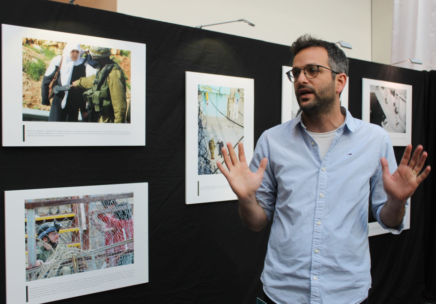 Nadav Weiman, Deputy Director of Breaking the Silence, at a photo exhibit at the European Parliament