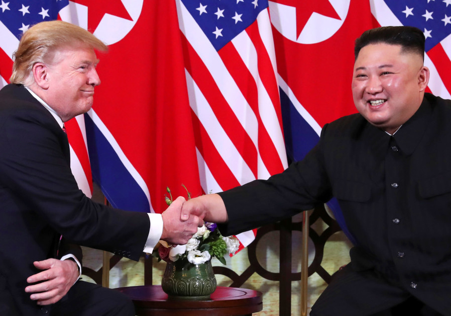 U.S. President Donald Trump and North Korean leader Kim Jong Un shake hands before their one-on-one