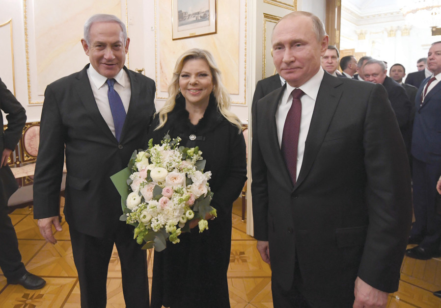 PRIME MINISTER Benjamin Netanyahu and his wife, Sara, enjoy a moment with Russian President Vladimir