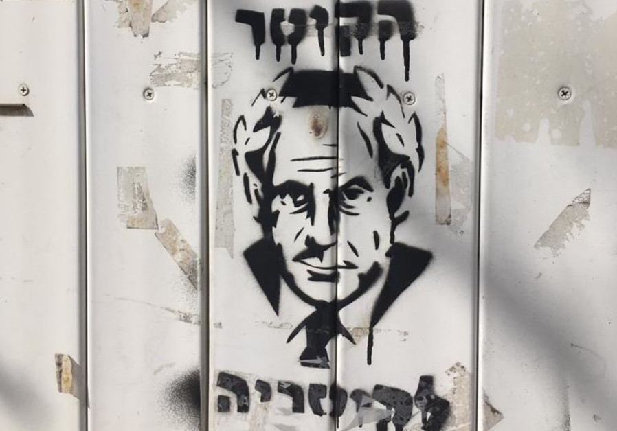 Graffiti spotted near demonstration protesting indictment charges against Benjamin Netanyahu