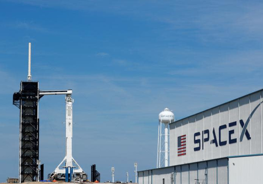 A SpaceX Falcon 9 carrying the Crew Dragon spacecraft sits on launch pad 39A