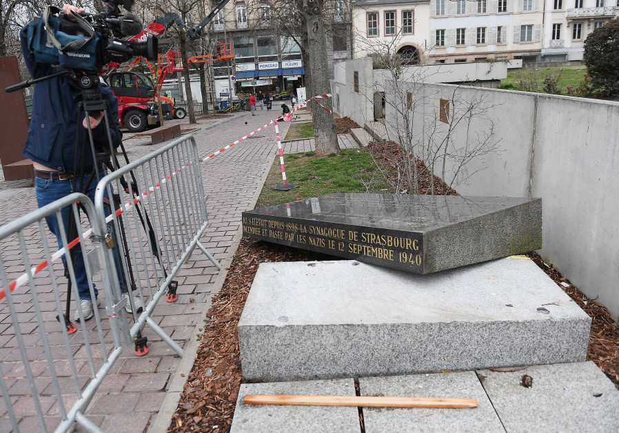 A cameraman films the memorial stone marking the site of Strasbourg's Old Synagogue
