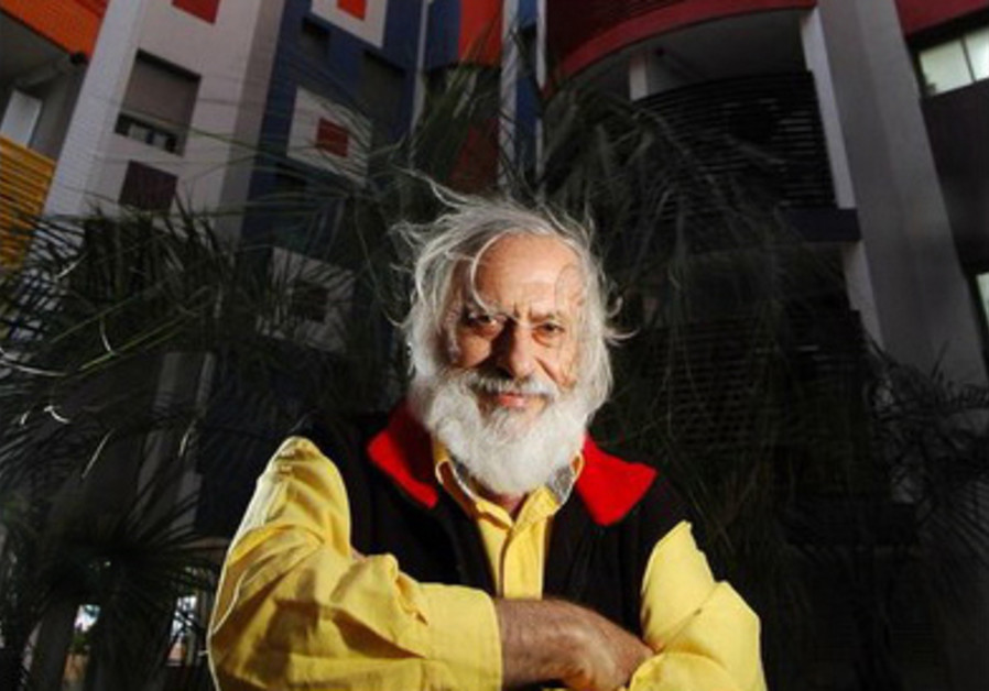 Yaacov Agam, 90, in front of a building he decorated in Tel Baruch