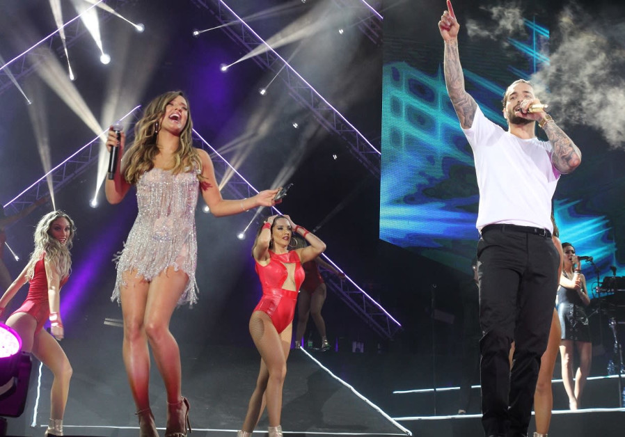 Maluma and Israeli singer Eden Ben-Zaken perform in Tel Aviv last year.