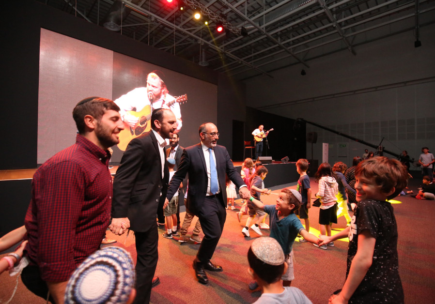 Jewish children dance with South Africa's Chief Rabbi Warren Goldstein