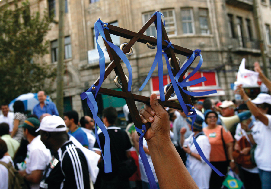 Christian supporters of Israel march in a parade.