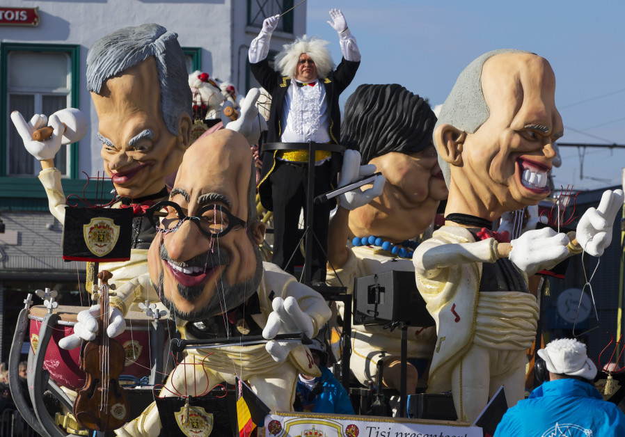 Giant figures depicting Belgian Prime Minister Charles Michel (C) and other politicians are seen dur