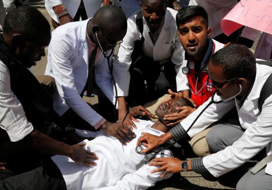 Kenyan student doctors perform a drill