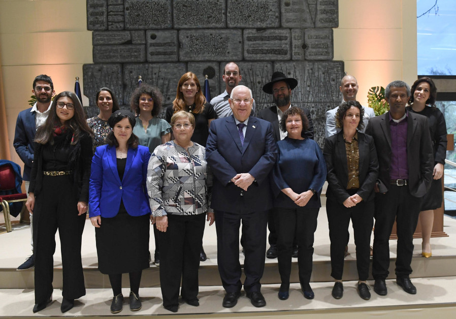 President Reuven Rivlin with the twelve doctoral students who received a prize for their theses