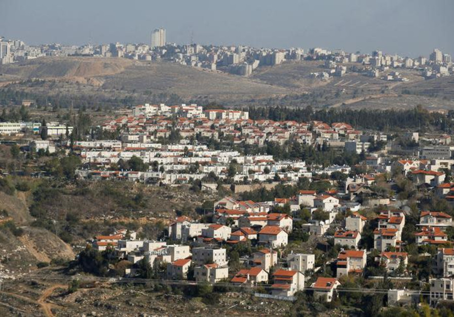 Houses are seen in the Israeli community of Givat Zeev (bottom) with the Palestinian Authority city