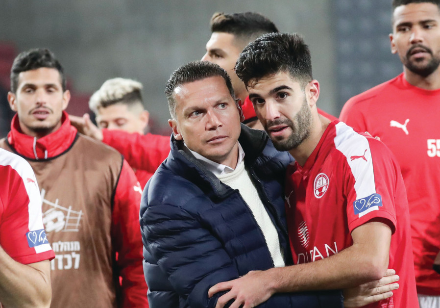 HAPOEL BEERSHEBA coach Barak Bachar (center) congratulates his players