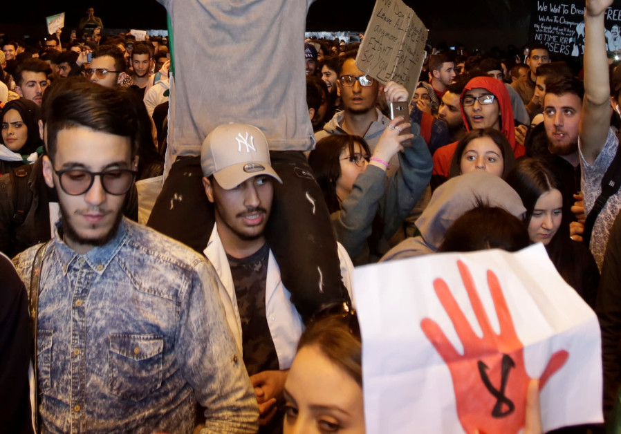 Students take part in a protest to denounce an offer by President Abdelaziz Bouteflika