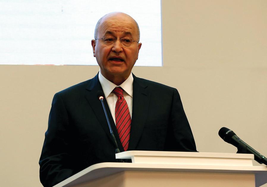 IRAQ'S PRESIDENT Barham Salih addresses a recent forum in Baghdad.