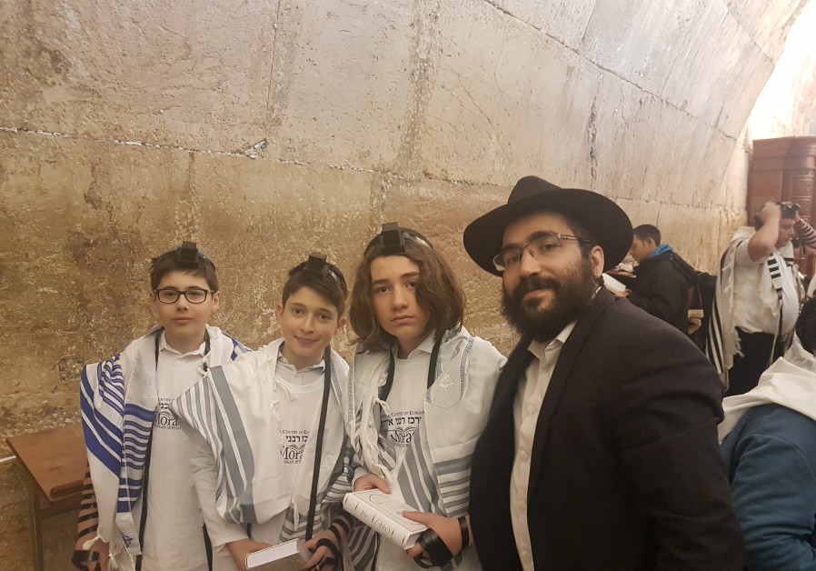 Bar mitzvah boys from Europe at the Western Wall in Jerusalem with the Rabbinical Council of Europe.