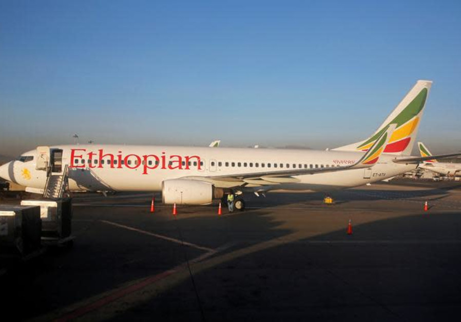 Workers service an Ethiopian Airlines Boeing 737-800 plane at the Bole International Airport