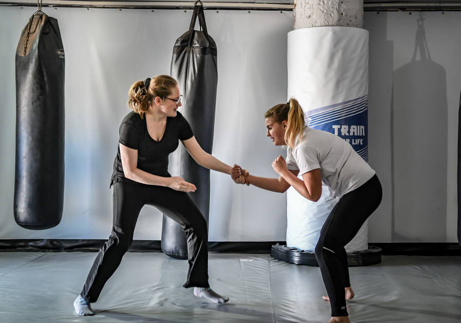 Women taking part in self-defense, physical fitness seminar at CrossFit Tel Aviv and Fight TLV (Shira Elimeleh)