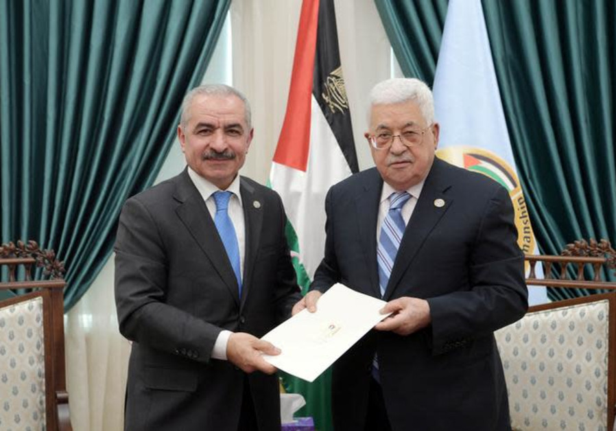 Senior Fatah official Mohammad Shtayyeh receives a designation letter from Palestinian President