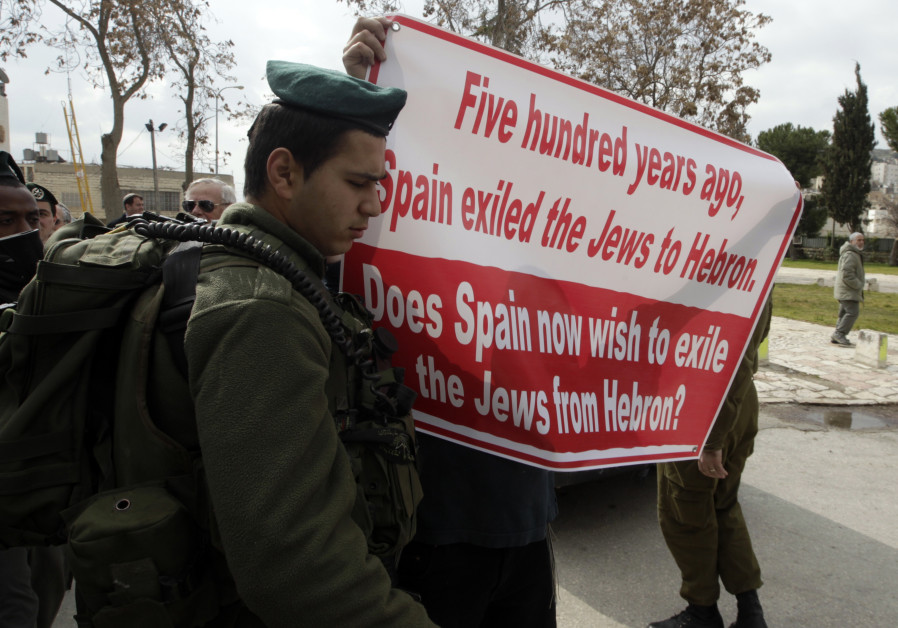 A Hebron citizen protests as Spain's Foreign Minister Trinidad Jiminez comes to visit, 2011.