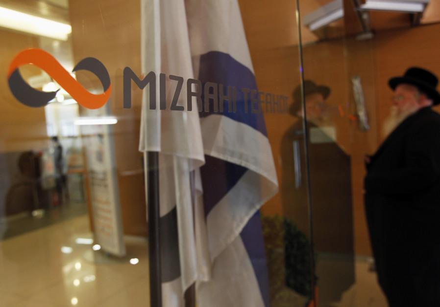 A man enters a branch of Mizrahi-Tefahot Bank in Jerusalem August 29, 2011.