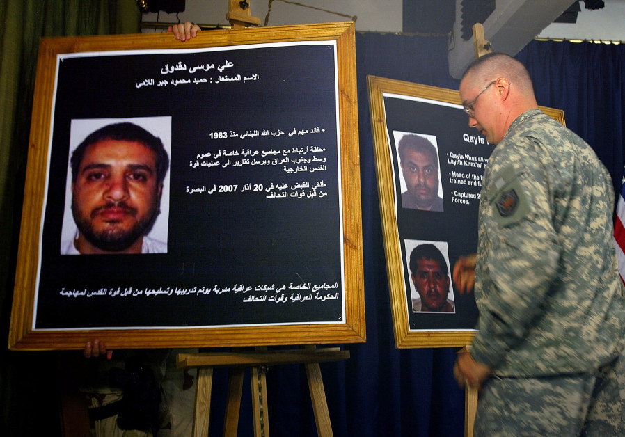 A U.S. solider shows a picture of Ali Mussa Daqduq during a news conference. (Reuters)