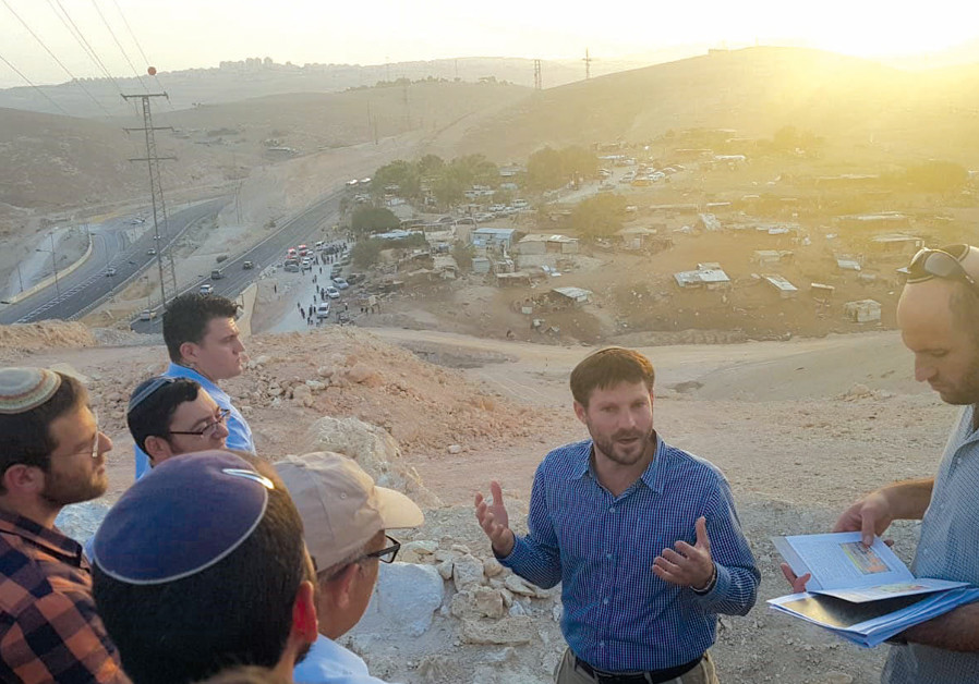 MK Bezalel Smotrich at the illegal Bedouin village of Khan Al-Ahmar, advocating for its demolition in October.