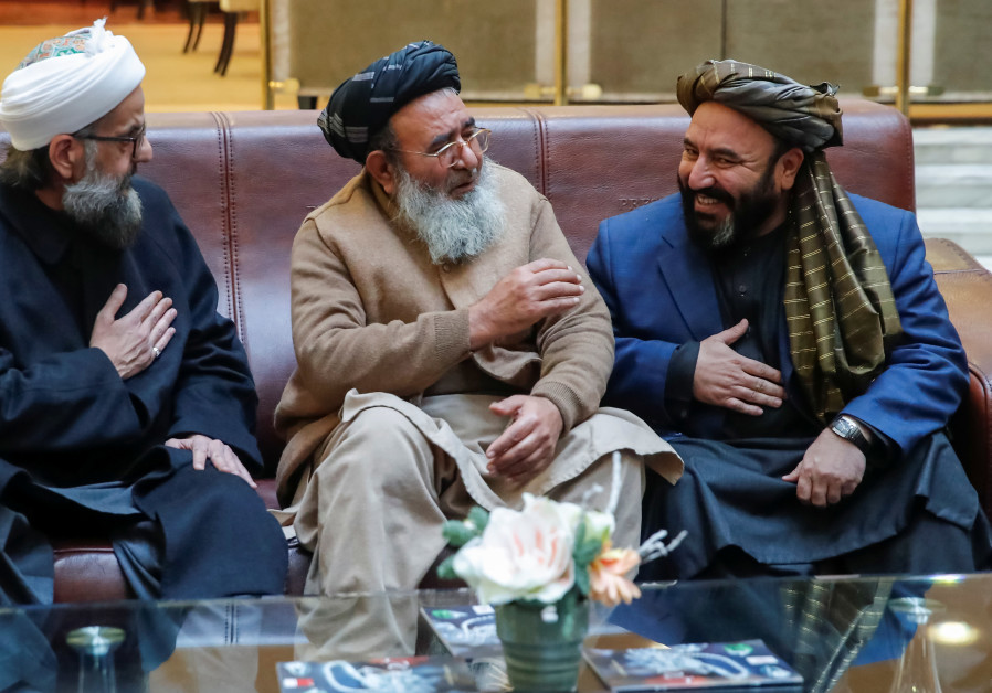 Participants gather before a conference with attendance of Taliban representatives arranged by the A