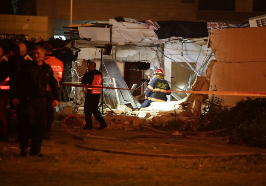 Rescue teams work to recover people from the building collapse in Ashdod