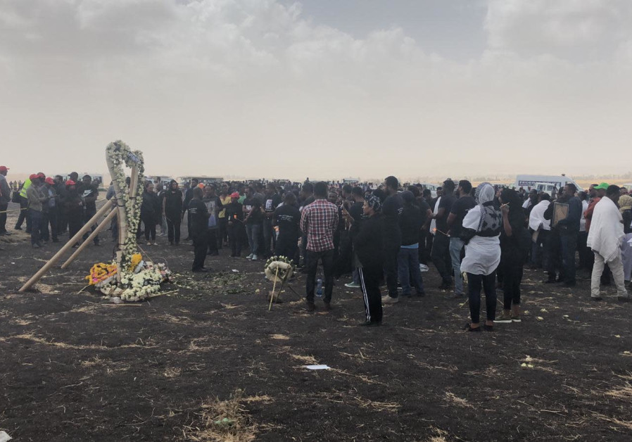 At Ethiopia flight memorial, white roses mark passing of lives