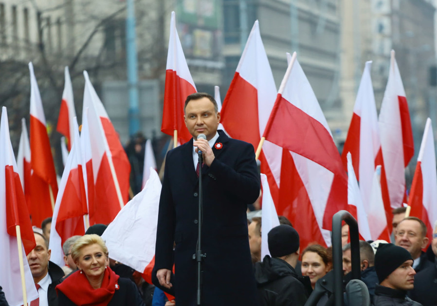 oland's President Andrzej Duda delivers a speech before the official start of a march marking the 10