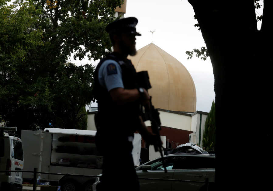 A police officer patrols outside Masjid Al Noor mosque after Friday's mosque attacks in Christchurch