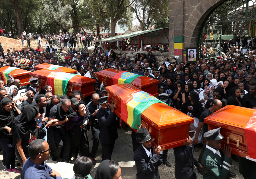 Pallbearers carry the coffins of the victims of the Ethiopian Airline Flight ET 302 plane crash, dur