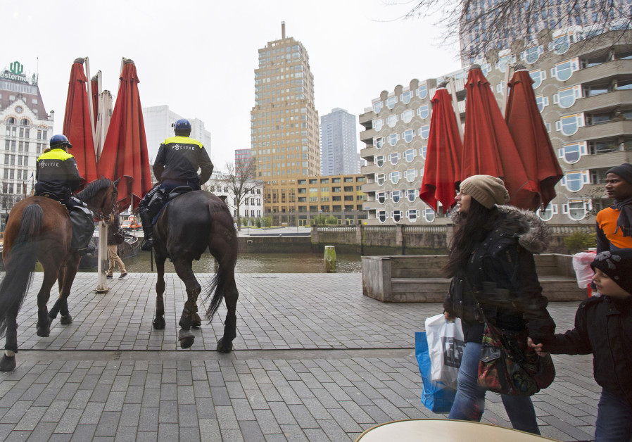 Dutch mounted police patrol in central Rotterdam ahead of the Europa League soccer match between Fey