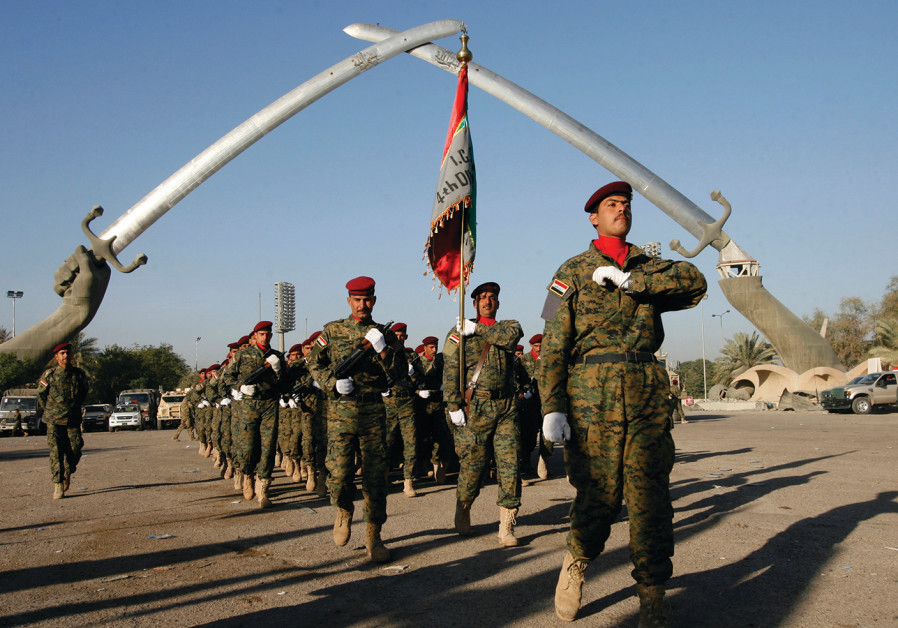 IRAQI SOLDIERS march during a rehearsal for Iraqi Army Day in Baghdad in 2009
