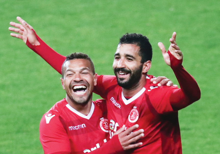 HAPOEL TEL AVIV defender Idan Cohen (right) celebrates with teammate  Claudemir after scoring his team s fifth goal in the 84th minute of the  Reds  5-1 rout ... 2b87dd5bb