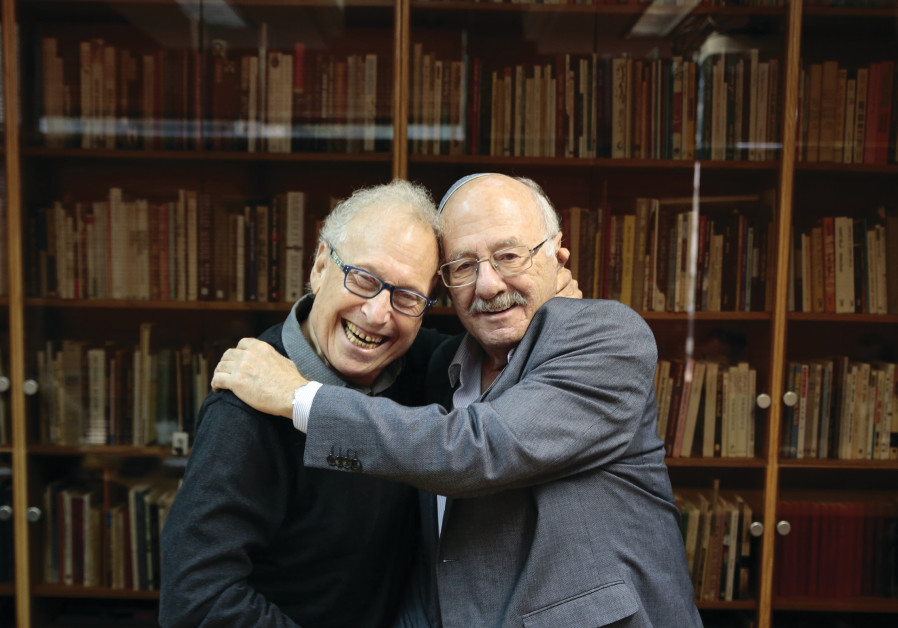DAN ALMAGOR (left) is embraced by National Library chairman David Blumberg.