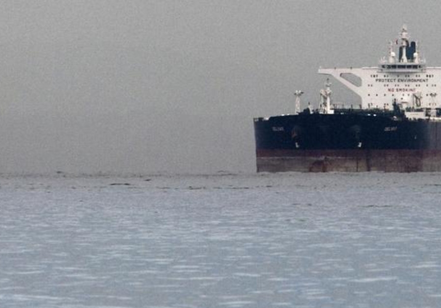 "Malta-flagged Iranian crude oil supertanker ""Delvar"" is seen anchored off Singapore March 1, 2012."