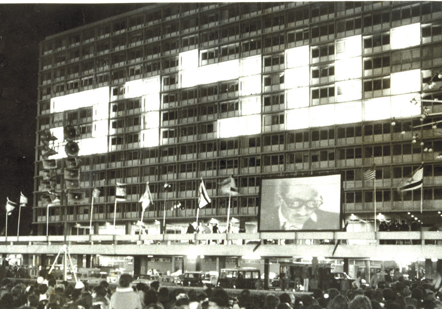 'INITIAL MOMENT of euphoria': After the signing, crowds in Malchei Israel Square (later renamed Rabin Square) watch an on-screen Sadat speak . (Lester J Millman)