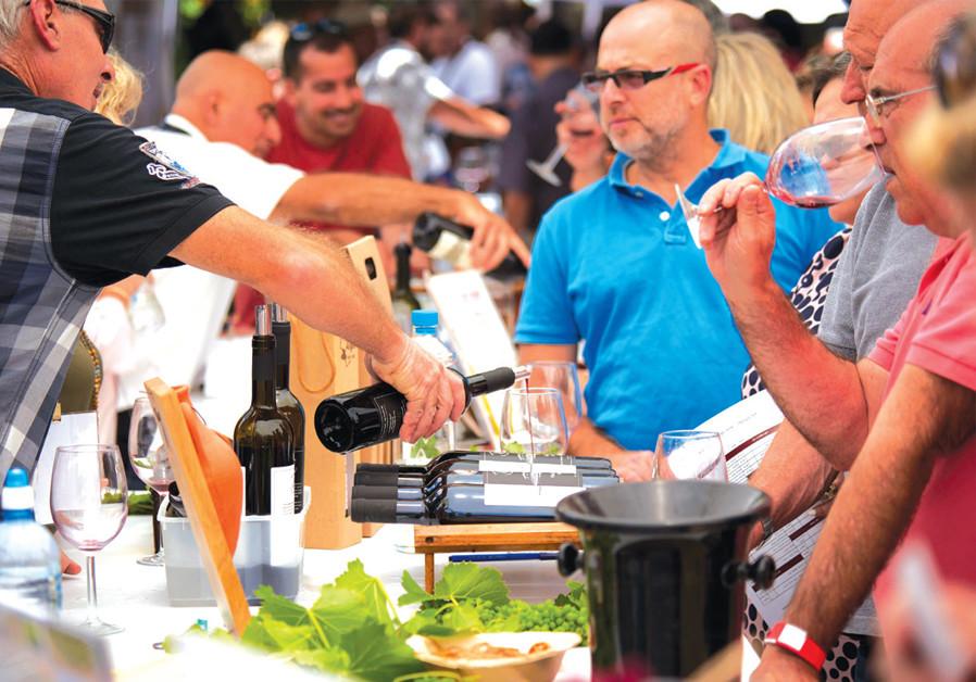 WINE LOVERS taste the grape at the Jerusalem Wine Festival.(Courtesy)