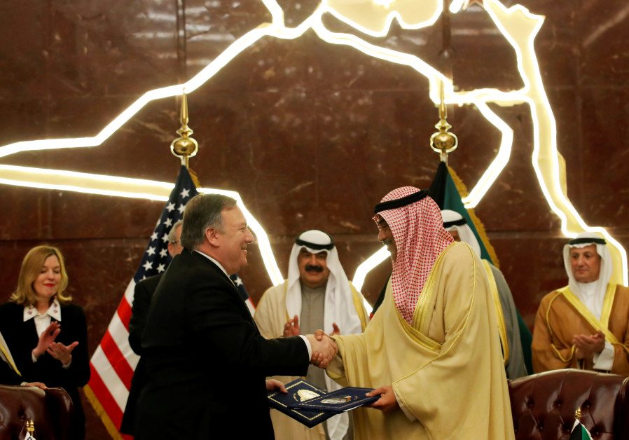U.S. Secretary of State Mike Pompeo shakes hands with Kuwait's Foreign Minister