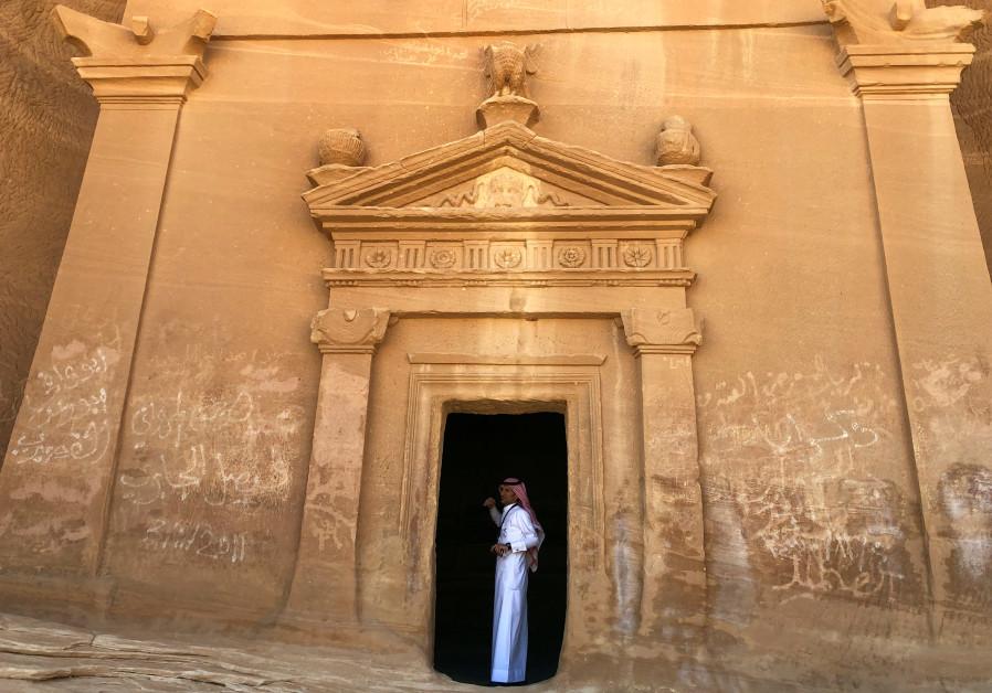 A Saudi tour guide stands inside a tomb at al-Ula (REUTERS/Stephen Kalin)