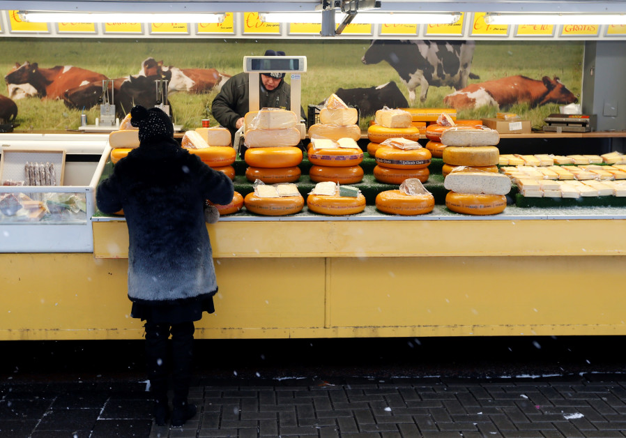 A vendor sells cheese during a weekly market in Volendam near Amsterdam