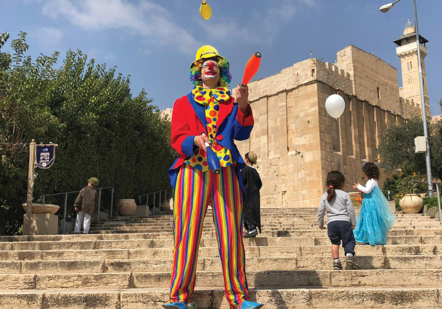CELEBRATING PURIM outside the Tomb of the Patriarchs in Hebron