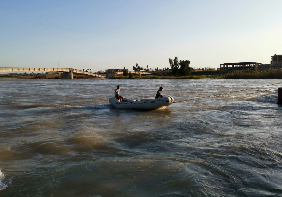 Iraqi rescuers search for survivors over the site where an overloaded ferry sank in the Tigris river