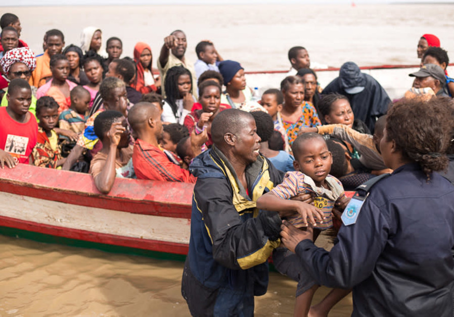 Survivors of Cyclone Idai arrive at an evacuation centre in Beira, Mozambique, March 21, 2019