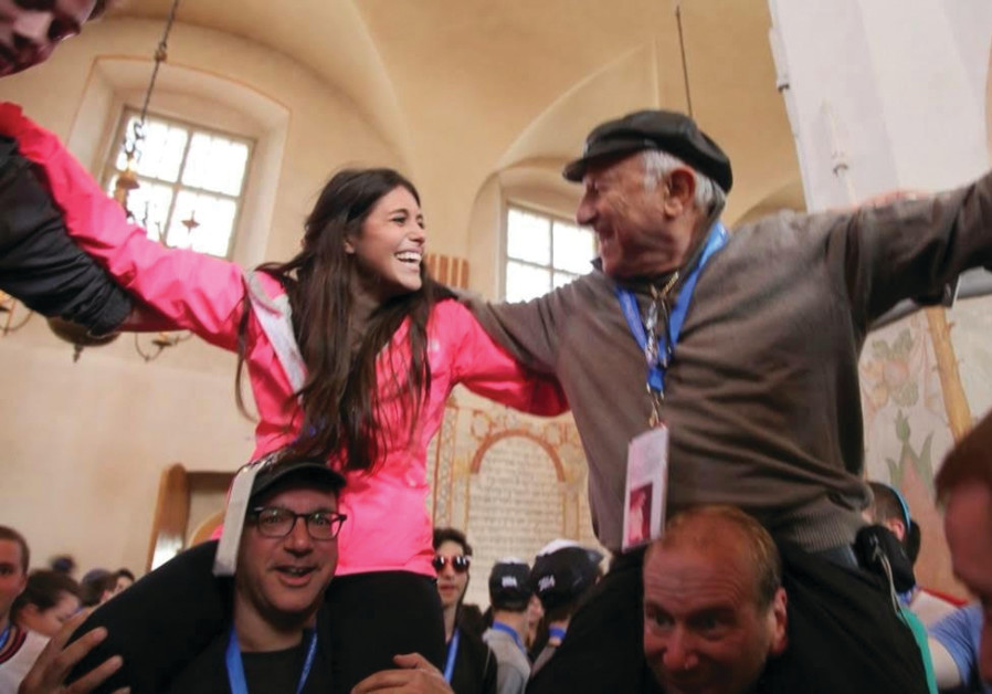 Nate Leipciger and his granddaughter, Jennifer Gree, take part in the March of the Living in Poland